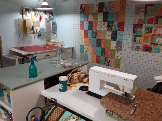 South east corner with cutting table and ironing station at the end of my sewing desk