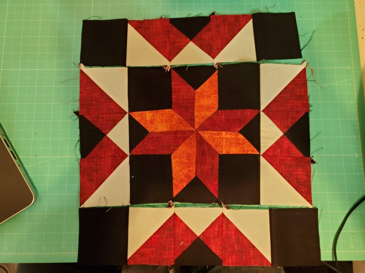Sew the 2 long sections to the center
